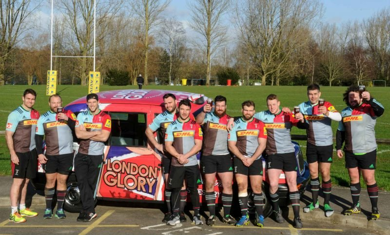 harlequins Team with beer and full wrap taxi