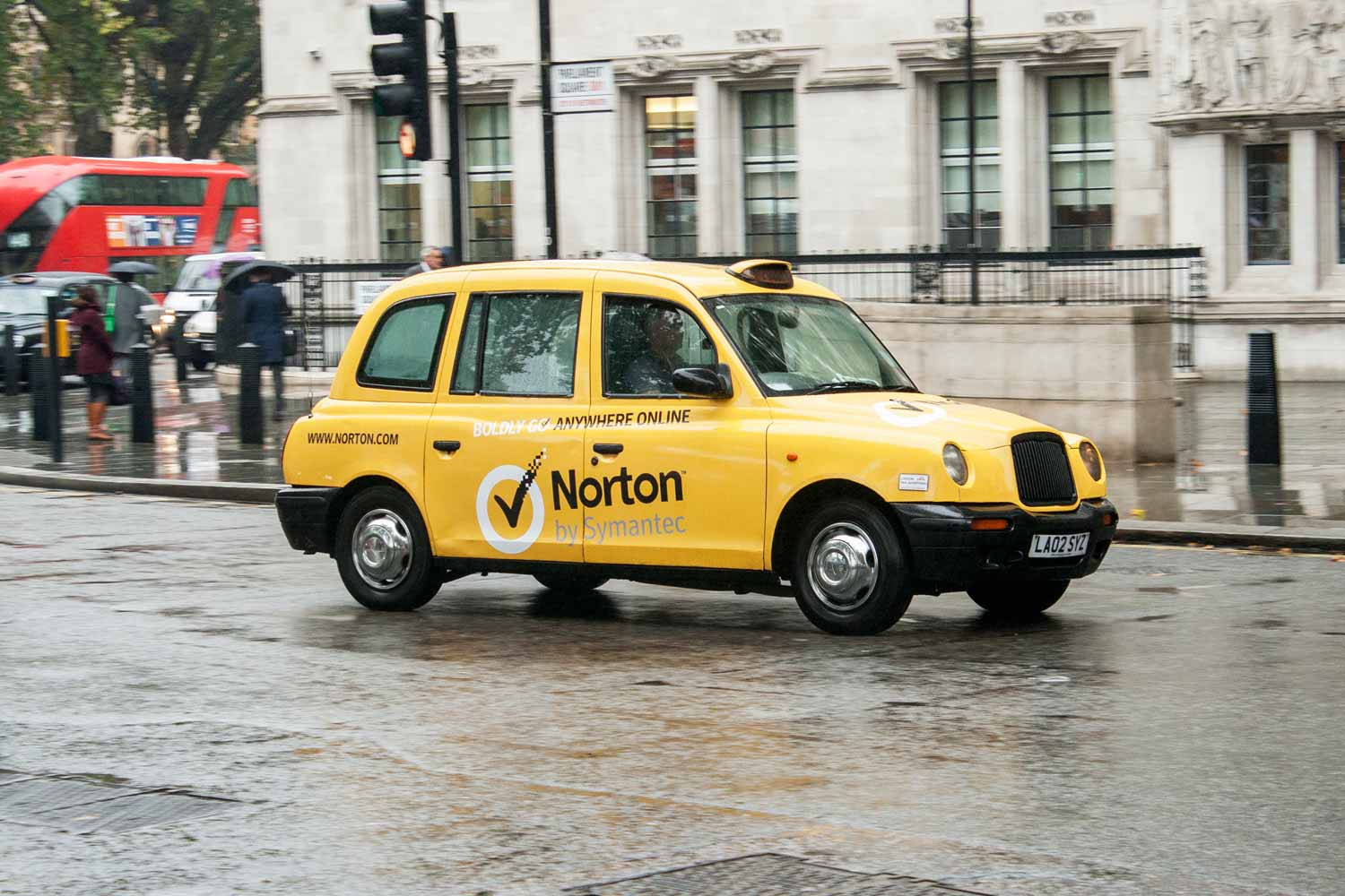 a full wrap taxi advertising norton anti virus software in london